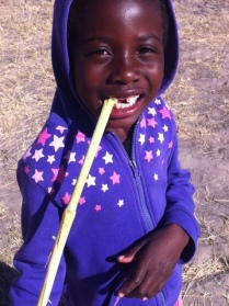 Julia enjoying some sugar cane