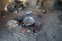 Making pap - the daily meal for people in Mayana made from Mahangu