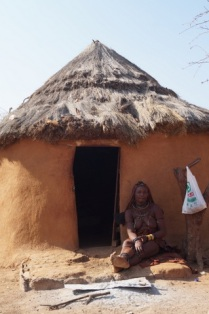 Himba lady in front of her hut